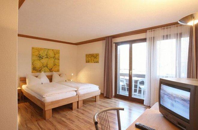 Zimmer mit Balkon im Hotel Alpha